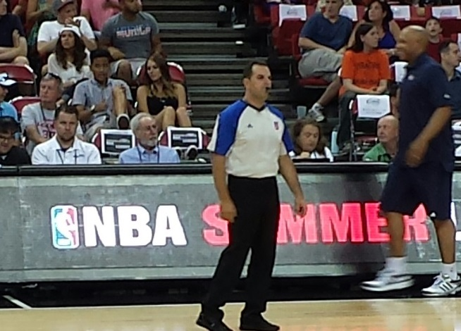 Marc Ratner (blue dress shirt) is seated at the scorer's table during NBA Summer League action at UNLV on July 12.