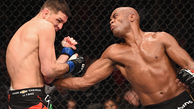 (R-L) <a href='../fighter/Anderson-Silva'>Anderson Silva</a> punches <a href='../fighter/Nick-Diaz'>Nick Diaz</a> in their middleweight bout during the UFC 183 event at the MGM Grand Garden Arena on January 31, 2015 in Las Vegas, Nevada. (Photo by Josh Hedges)