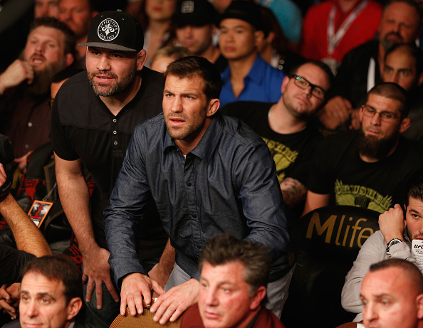 LAS VEGAS, NV - JANUARY 03: UFC middleweight Luke Rockhold and UFC heavyweight champion Cain Velasquez look on as their teammate Daniel Cormier competes at UFC 182 at the MGM Grand Garden Arena on January 3, 2015 in Las Vegas, Nevada. (Photo by Josh Hedges/Zuffa LLC/Zuffa LLC via Getty Images)