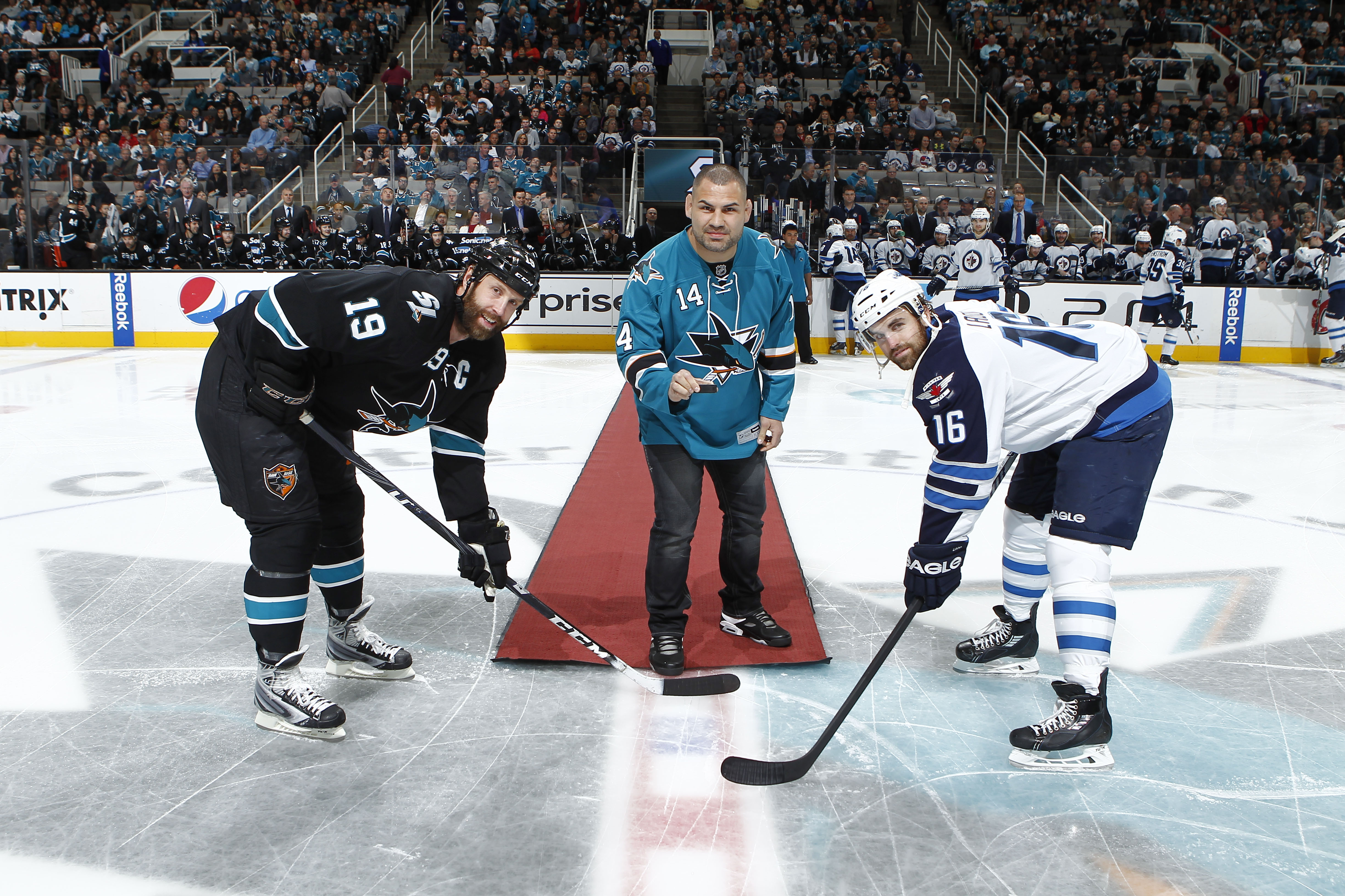 Heavyweight champion Cain Velasquez drops the puck at the San Jose Sharks game against the Winnipeg Jets on Thursday night.