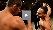 Welterweights Jake Ellenberger and Jay Hieron square off as flyweight contenders John Dodson and Jussier Formiga share a spirited pose on stage.