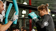 UFC women's bantamweight champion Ronda Rousey works out for the media at Glendale Fighting Club before her bout with Sara McMann at UFC 170.