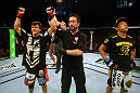 Brian Bowles celebrates after defeating Takeya Mizugaki.