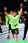 Dennis Siver celebrates his win by unanimous decision over Matt Wiman