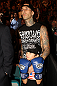 Musician Travis Barker and his son take in the fights at UFC 132.
