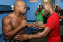 (R-L) World Champion boxer Bernard Hopkins gives Rashad Evans some boxing tips in the locker room at the Joe Hand Gym