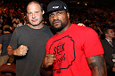 "UFC 133: Quinton ""Rampage"" Jackson and designer Reed Krakoff pose for a photo octagonside."