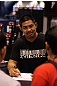 Mark Munoz signs autographs for fans