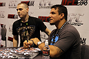 Frank Mir signs autographs for a fan