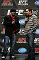 TORONTO, ON - DECEMBER 09:  (L-R) UFC Middleweight contender Mark Munoz and UFC commentator Mike Goldberg interacts with fans during a Q&A session before the UFC 140 Official Weigh-in at the Air Canada Centre on December 9, 2011 in Toronto, Canada.  (Photo by Josh Hedges/Zuffa LLC/Zuffa LLC via Getty Images)