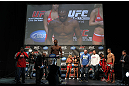 "TORONTO, ON - DECEMBER 09:  UFC Light Heavyweight Champion Jon ""Bones"" Jones weighs in as opponent Lyoto Machida (red shorts) looks on during the UFC 140 Official Weigh-in at the Air Canada Centre on December 9, 2011 in Toronto, Canada.  (Photo by Josh Hedges/Zuffa LLC/Zuffa LLC via Getty Images)"