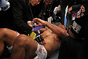 TORONTO, ON - DECEMBER 10:  Antonio Rodrigo Nogueira receives treatment from the doctors after suffering a separated shoulder against Frank Mir during the UFC 140 event at Air Canada Centre on December 10, 2011 in Toronto, Ontario, Canada.  (Photo by Nick Laham/Zuffa LLC/Zuffa LLC via Getty Images)