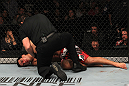 "TORONTO, ON - DECEMBER 10:  Lyoto Machida lies on the canvas unconscious after being defeated by Jon ""Bones"" Jones during the UFC 140 event at Air Canada Centre on December 10, 2011 in Toronto, Ontario, Canada.  (Photo by Nick Laham/Zuffa LLC/Zuffa LLC via Getty Images)"