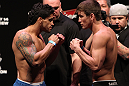RIO DE JANEIRO, BRAZIL - JANUARY 13:  (L-R) Opponents Thiago Tavares and Sam Stout face off after weighing in during the UFC 142 Weigh In at HSBC Arena on January 13, 2012 in Rio de Janeiro, Brazil.  (Photo by Josh Hedges/Zuffa LLC/Zuffa LLC via Getty Images)