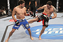 CHICAGO, IL - JANUARY 28:  (R-L) Chris Weidman kicks Demian Maia during the UFC on FOX event at United Center on January 28, 2012 in Chicago, Illinois.  (Photo by Nick Laham/Zuffa LLC/Zuffa LLC via Getty Images) *** Local Caption *** Chris Weidman; Demian Maia