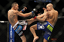 LAS VEGAS, NV - FEBRUARY 04:  Max Holloway (left) kicks Dustin Poirier during the UFC 143 event at Mandalay Bay Events Center on February 4, 2012 in Las Vegas, Nevada.  (Photo by Josh Hedges/Zuffa LLC/Zuffa LLC via Getty Images) *** Local Caption *** Max Holloway; Dustin Poirier