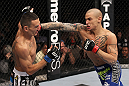 LAS VEGAS, NV - FEBRUARY 04:  Dustin Poirier (right) punches Max Holloway during the UFC 143 event at Mandalay Bay Events Center on February 4, 2012 in Las Vegas, Nevada.  (Photo by Nick Laham/Zuffa LLC/Zuffa LLC via Getty Images) *** Local Caption *** Dustin Poirier; Max Holloway