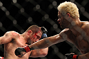 LAS VEGAS, NV - FEBRUARY 04:  Josh Koscheck (right) punches Mike Pierce during the UFC 143 event at Mandalay Bay Events Center on February 4, 2012 in Las Vegas, Nevada.  (Photo by Josh Hedges/Zuffa LLC/Zuffa LLC via Getty Images) *** Local Caption *** Josh Koscheck; Mike Pierce