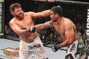 LAS VEGAS, NV - FEBRUARY 04:  (L-R) Roy Nelson and Fabricio Werdum exchange punches during the UFC 143 event at Mandalay Bay Events Center on February 4, 2012 in Las Vegas, Nevada.  (Photo by Nick Laham/Zuffa LLC/Zuffa LLC via Getty Images) *** Local Caption *** Fabricio Werdum; Roy Nelson