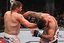 LAS VEGAS, NV - FEBRUARY 04:  (L-R) Roy Nelson punches Fabricio Werdum during the UFC 143 event at Mandalay Bay Events Center on February 4, 2012 in Las Vegas, Nevada.  (Photo by Nick Laham/Zuffa LLC/Zuffa LLC via Getty Images) *** Local Caption *** Roy Nelson; Fabricio Werdum