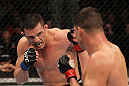 OMAHA, NE - FEBRUARY 15:  (L-R) Jake Ellenberger punches Diego Sanchez during the UFC on FUEL TV event at Omaha Civic Auditorium on February 15, 2012 in Omaha, Nebraska.  (Photo by Josh Hedges/Zuffa LLC/Zuffa LLC via Getty Images) *** Local Caption *** Jake Ellenberger; Diego Sanchez