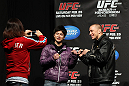 SAITAMA, JAPAN - FEBRUARY 25:  UFC Welterweight Champion Georges St-Pierre poses for photos with fans before the official UFC 144 weigh in at the Saitama Super Arena on February 25, 2012 in Saitama, Japan.  (Photo by Josh Hedges/Zuffa LLC/Zuffa LLC via Getty Images) *** Local Caption *** Georges St-Pierre