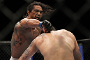 SAITAMA, JAPAN - FEBRUARY 26:  (L-R) Benson Henderson punches Frankie Edgar during the UFC 144 event at Saitama Super Arena on February 26, 2012 in Saitama, Japan.  (Photo by Josh Hedges/Zuffa LLC/Zuffa LLC via Getty Images) *** Local Caption *** Frankie Edgar; Benson Henderson