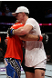 EAST RUTHERFORD, NJ - MAY 05:  Danny Castillo (L) hugs John Cholish (R) after thier Lightweight bout at Izod Center on May 5, 2012 in East Rutherford, New Jersey.  (Photo by Josh Hedges/Zuffa LLC/Zuffa LLC via Getty Images)