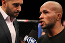 SUNRISE, FL - JUNE 08:   (R-L) Demetrious Johnson is interviewed by Jon Anik after his decision victory over Ian McCall in a Flyweight bout during the UFC on FX 3 event at Bank Atlantic Center on June 8, 2012 in Sunrise, Florida.  (Photo by Josh Hedges/Zuffa LLC/Zuffa LLC via Getty Images)