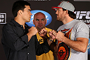 LOS ANGELES - AUGUST 02: (L-R) Opponents Lyoto Machida and Ryan Bader face off during the UFC on FOX press conference at the J.W. Marriott on August 2, 2012 in Los Angeles, California. (Photo by Josh Hedges/Zuffa LLC/Zuffa LLC via Getty Images)