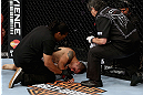 LOS ANGELES, CA - AUGUST 04:  Ulysses Gomez is tended to after John Moraga knocked him out in the first round during the UFC on FOX event at Staples Center on August 4, 2012 in Los Angeles, California.  (Photo by Josh Hedges/Zuffa LLC via Getty Images)