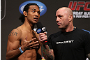 DENVER, CO - AUGUST 10:  (L-R) Benson Henderson is interviewed by Joe Rogan during the UFC 150 weigh in at Pepsi Center on August 10, 2012 in Denver, Colorado. (Photo by Josh Hedges/Zuffa LLC/Zuffa LLC via Getty Images)