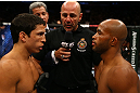 TORONTO, CANADA - SEPTEMBER 22: Opponents Joseph Benavidez (L) and Demetrious Johnson (R) receive final instructions from referee Yves Lavigne before their flyweight championship bout at UFC 152 inside Air Canada Centre on September 22, 2012 in Toronto, Ontario, Canada. (Photo by Al Bello/Zuffa LLC/Zuffa LLC via Getty Images)