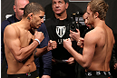 NOTTINGHAM, ENGLAND - SEPTEMBER 28:  (L-R) Opponents DaMarques Johnson and Gunnar Nelson face off during the UFC on Fuel TV weigh in at Capital FM Arena on September 28, 2012 in Nottingham, England.  (Photo by Josh Hedges/Zuffa LLC/Zuffa LLC via Getty Images)