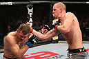 NOTTINGHAM, ENGLAND - SEPTEMBER 29:  (R-L) Strefan Struve punches Stipe Miocic during their heavyweight fight at the UFC on Fuel TV event at Capital FM Arena on September 29, 2012 in Nottingham, England.  (Photo by Josh Hedges/Zuffa LLC/Zuffa LLC via Getty Images)
