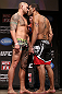 MINNEAPOLIS, MN - OCTOBER 04:  Opponents Travis Browne (L) and Antonio