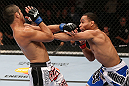 MINNEAPOLIS, MN - OCTOBER 05:  (R-L) John Dodson punches Jussier Formiga during their flyweight fight at the UFC on FX event at Target Center on October 5, 2012 in Minneapolis, Minnesota.  (Photo by Josh Hedges/Zuffa LLC/Zuffa LLC via Getty Images)