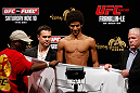 MACAU, MACAU - NOVEMBER 09:  Alex Caceres makes weight during the UFC Macau weigh in at Cotai Arena on November 9, 2012 in Macau, Macau.  (Photo by Josh Hedges/Zuffa LLC/Zuffa LLC via Getty Images)