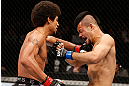 MACAU, MACAU - NOVEMBER 10:  (L-R) Alex Caceres punches Motonobu Tezuka during their bantamweight bout at the UFC Macao event inside CotaiArena on November 10, 2012 in Macau, Macau.  (Photo by Josh Hedges/Zuffa LLC/Zuffa LLC via Getty Images)