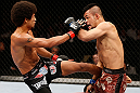 MACAU, MACAU - NOVEMBER 10:  (L-R) Alex Caceres kicks Motonobu Tezuka during their bantamweight bout at the UFC Macao event inside CotaiArena on November 10, 2012 in Macau, Macau.  (Photo by Josh Hedges/Zuffa LLC/Zuffa LLC via Getty Images)