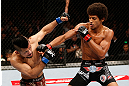 MACAU, MACAU - NOVEMBER 10:  (R-L) Alex Caceres punches Motonobu Tezuka during their bantamweight bout at the UFC Macao event inside CotaiArena on November 10, 2012 in Macau, Macau.  (Photo by Josh Hedges/Zuffa LLC/Zuffa LLC via Getty Images)