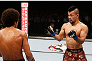 MACAU, MACAU - NOVEMBER 10:  (R-L) Motonobu Tezuka taunts Alex Caceres during their bantamweight bout at the UFC Macao event inside CotaiArena on November 10, 2012 in Macau, Macau.  (Photo by Josh Hedges/Zuffa LLC/Zuffa LLC via Getty Images)