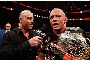 MONTREAL, QC - NOVEMBER 17:  Georges St-Pierre (R) talks with Joe Rogan after defeating Carlos Condit by a unanimous decision to retain his welterweight title during UFC 154 on November 17, 2012  at the Bell Centre in Montreal, Canada.  (Photo by Josh Hedges/Zuffa LLC/Zuffa LLC via Getty Images)