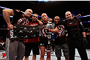 MONTREAL, QC - NOVEMBER 17:  Georges St-Pierre celebrates with his team after defeating Carlos Condit by a unanimous decision to retain his welterweight title during UFC 154 on November 17, 2012  at the Bell Centre in Montreal, Canada.  (Photo by Josh Hedges/Zuffa LLC/Zuffa LLC via Getty Images)