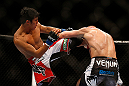 SEATTLE, WA - DECEMBER 08:  (L-R) Nam Phan kicks Dennis Siverduring their featherweight bout at the UFC on FOX event on December 8, 2012  at Key Arena in Seattle, Washington.  (Photo by Josh Hedges/Zuffa LLC/Zuffa LLC via Getty Images) *** Local Caption *** Dennis Siver; Nam Phan