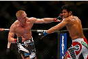 SEATTLE, WA - DECEMBER 08:  (L-R) Dennis Siver punches Nam Phan during their featherweight bout at the UFC on FOX event on December 8, 2012  at Key Arena in Seattle, Washington.  (Photo by Josh Hedges/Zuffa LLC/Zuffa LLC via Getty Images) *** Local Caption *** Dennis Siver; Nam Phan