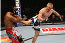 SEATTLE, WA - DECEMBER 08:  (R-L) Dennis Siver kicks Nam Phan during their featherweight bout at the UFC on FOX event on December 8, 2012  at Key Arena in Seattle, Washington.  (Photo by Ezra Shaw/Zuffa LLC/Zuffa LLC via Getty Images) *** Local Caption *** Dennis Siver; Nam Phan