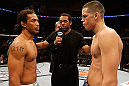 SEATTLE, WA - DECEMBER 08:  Benson Henderson (left) and Nate Diaz (right) stare eachother down before their lightweight championship bout at the UFC on FOX event on December 8, 2012  at Key Arena in Seattle, Washington.  (Photo by Josh Hedges/Zuffa LLC/Zuffa LLC via Getty Images) *** Local Caption *** Benson Henderson; Nate Diaz