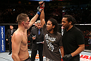 SEATTLE, WA - DECEMBER 08:  Nate Diaz (left) raises Benson Henderson's hand after their lightweight championship bout at the UFC on FOX event on December 8, 2012  at Key Arena in Seattle, Washington.  (Photo by Ezra Shaw/Zuffa LLC/Zuffa LLC via Getty Images) *** Local Caption *** Benson Henderson; Nate Diaz