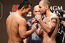 LAS VEGAS, NV - DECEMBER 28:  (L-R) Opponents Yushin Okami and Alan Belcher face off during the UFC 155 weigh-in on December 28, 2012 at MGM Grand Garden Arena in Las Vegas, Nevada. (Photo by Josh Hedges/Zuffa LLC/Zuffa LLC via Getty Images)